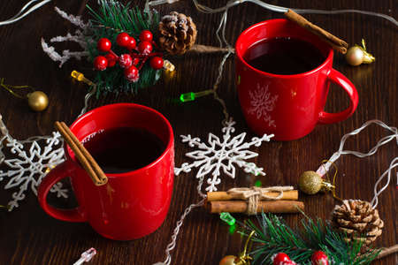 Cinnamon mulled wine in two red cups. Waiting for Christmas, view from the top Stock Photo
