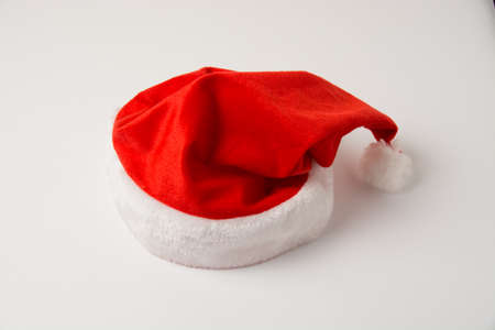 Volumetric santa hat on white background, isolate close-up with copy space.