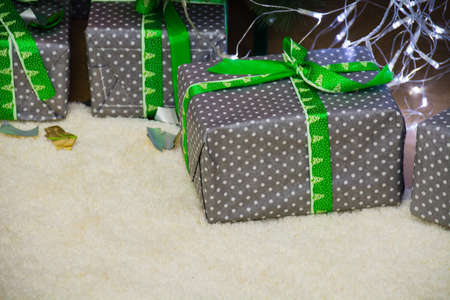 Gift boxes close-up under a christmas tree, copy space. Standard-Bild