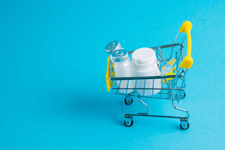 Medicines in a shopping cart for a shopper. The concept of medicine and the cost of treatment