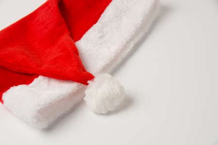Santa hat on white background, isolate close up with copy space.