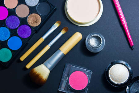 black makeup: Set of professional cosmetics for make-up on black background. Cosmetic products for makeup. Stock Photo