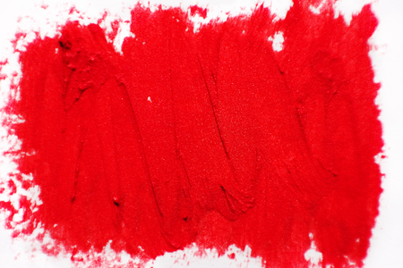 dabs: The texture of brush strokes of red lipstick. Background with dabs of red paint. Stock Photo