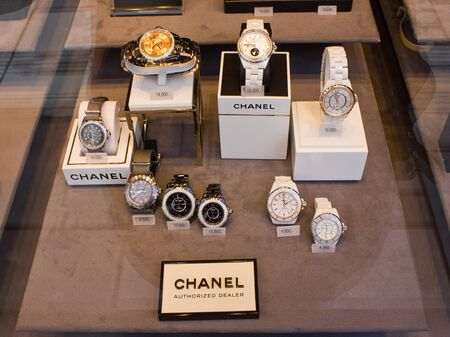 luxury goods: Vienna, Austria, 22 March 2016: Chanel Watch In Shop Window Display. Founded in 1909 is a high fashion house that specializes in haute couture clothes, luxury goods and fashion accessories.