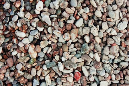 Background of pebbles. Texture building shingle.