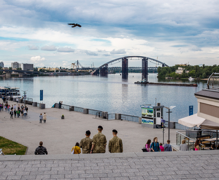May 25, 2017, Kiev, Ukraine: three soldiers are walking along Poshtova Square. Kiev cityscape with a view of the Dnieper River. Editorial