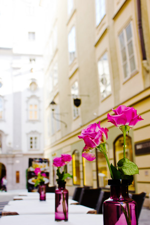 The summer platform of cafe on streets of old Salzburg, Austria. A romantic dinner at restaurant. Reklamní fotografie