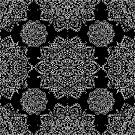 Seamless mandala medallion pattern in black and white.