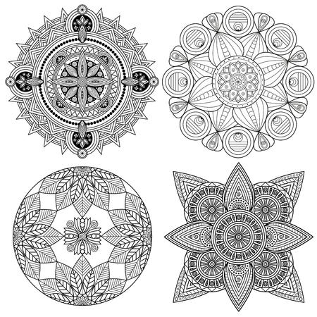 Set of four black and white mandala patterns.