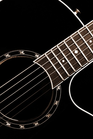 country music: Classical guitar closeup - includes strings, fingerboard and part of the body. Can be used as a nice background, album cover. Dark colours, contrast