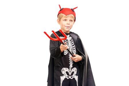 Studio portrait of little boy in Halloween costume against white background Stock Photo