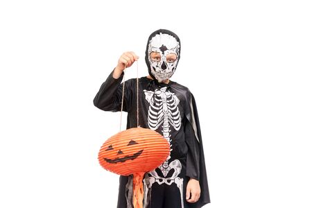 Studio portrait of little boy in Halloween costume against white background Stock Photo