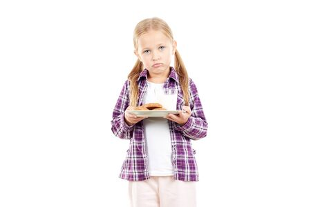 Portrait of little girl holding plate with cookies Stock Photo