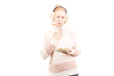 Portrait of senior woman wearing sweater and earmuffs