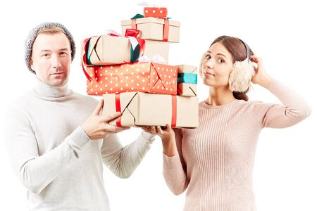 Portrait of beautiful couple holding heap of Christmas gifts