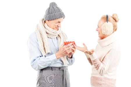 Portrait of cute senior couple celebrating Christmas Stock Photo