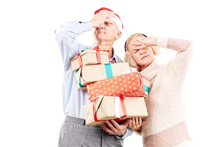 Portrait of cute senior couple celebrating Christmas Фото со стока