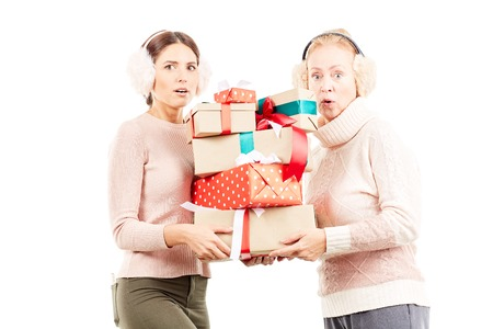 Portrait of senior mother and adult daughter exchanging Christmas gifts Stock Photo