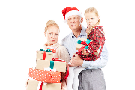 Christmas portrait of grandparents and granddaughter posing with gifts Stock Photo