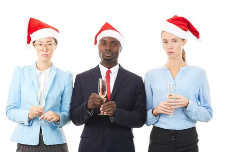 Portrait of three multi-ethnic office workers celebrating Christmas Stock Photo
