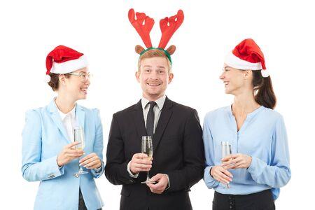 Portrait of office workers wearing Santa hats and reindeer headbands celebrating Christmas