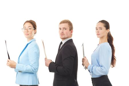 Portrait of three office workers standing one after another on white background