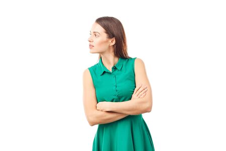 Portrait of emotional young woman in emerald green dress on white background Stock Photo