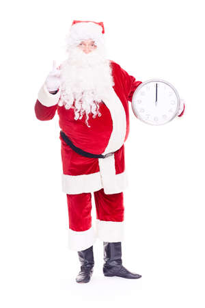 Portrait of Santa Claus in traditional costume holding clocks showing midnight