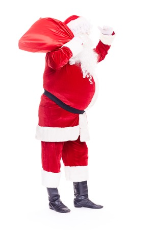 Portrait of Christmas character Santa Claus in traditional costume with red sack on white background Stockfoto