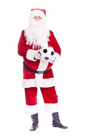 Portrait of Santa Claus holding soccer ball on white background Stock Photo