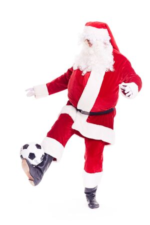 Portrait of Santa Claus playing soccer ball on white background Stock Photo