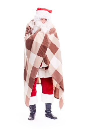 Isolated portrait of Christmas character Santa Claus wrapped in blanket