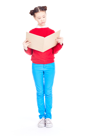 Portrait of Asian girl holding open textbook and studying on white background