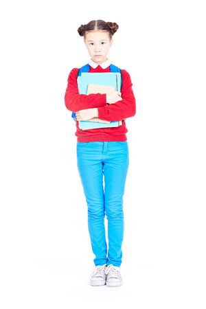 Portrait of female student holding notebooks and textbooks on white background