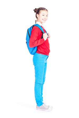 Studio portrait of schoolgirl posing with backpack on white background Stock Photo