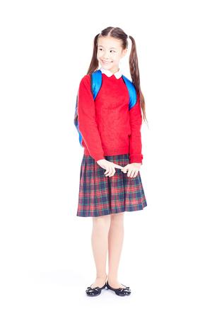 Asian female elementary student in school uniform posing on white background