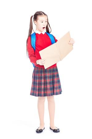 Full length portrait of Korean schoolgirl holding open notebook Stock Photo