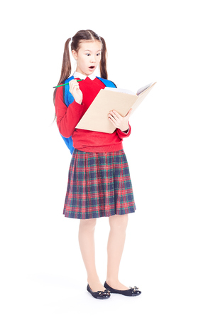 Full length portrait of Korean schoolgirl holding open notebook and pencil