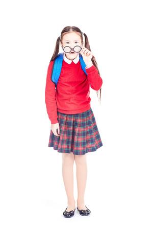 Portrait of nearsighted Asian schoolgirl wearing eyeglasses on white background Stock Photo