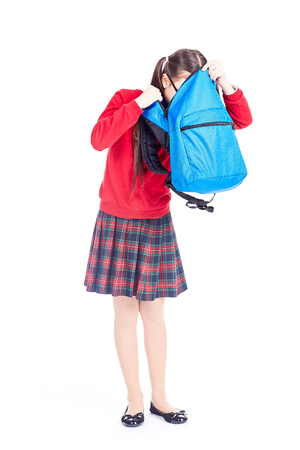 Asian girl in school uniform searching for something in her backpack Stock Photo