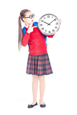 Portrait of Asian girl in school uniform holding clock on white background