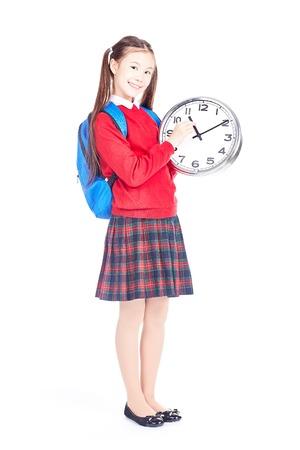 Portrait of Asian girl in school uniform holding clock on white background
