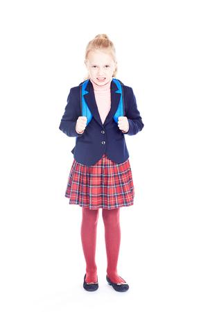 Studio portrait of beautiful blonde elementary student wearing school uniform