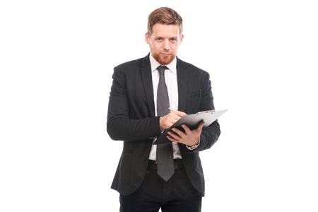 Studio portrait of business coach holding clipboard