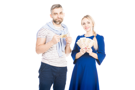 Portrait of young couple with money Фото со стока