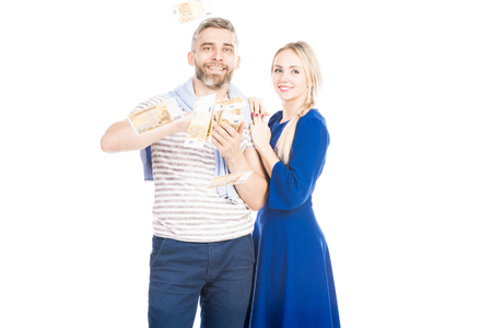 Portrait of happy couple with bunch of money banknotes