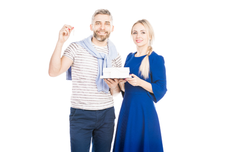 Portrait of couple with keys from new home