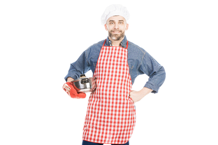 Portrait of middle-aged Caucasian male chef with saucepan looking at camera on white background