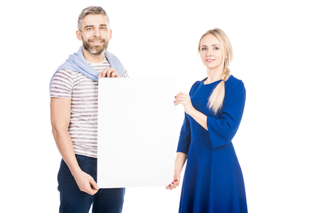 Attractive couple holding blank sign isolated on white background Фото со стока