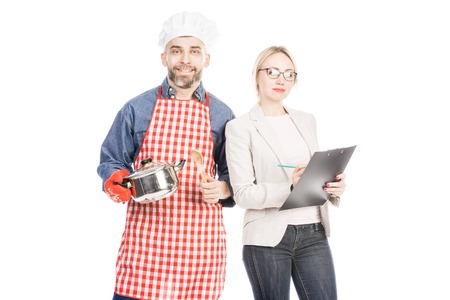 Portrait of male cook with saucepan and female manager with clipboard looking at camera on white background
